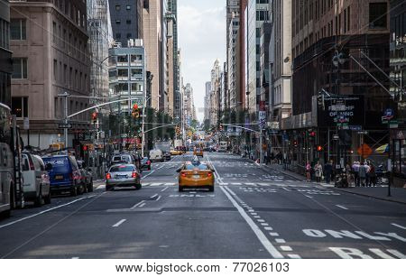 NEW YORK CITY, USA - OCTOBER, 2014: Few cars driving on Broadway in New York City