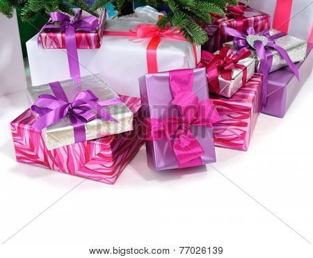 gifts under Christmas tree isolated on white background