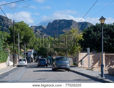 Street with cars and mountain