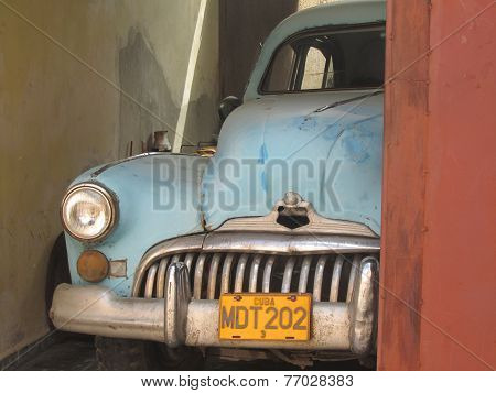 Old-fashioned Cuban Car In A Garage