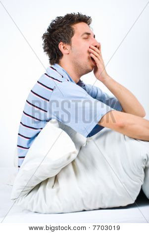 Man Yawning And Preparing For Sleep