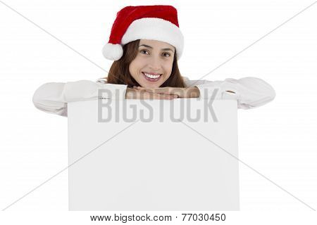 Christmas Business Woman Leaning On Blank Billboard With Copyspace
