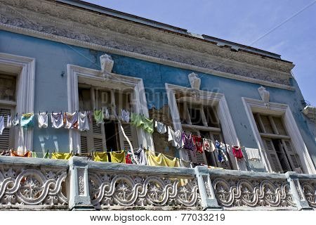 Clothes Hang Out In A Typical Colonial House
