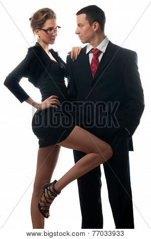 Beautiful sexy lady seducing young businessman isolated on white