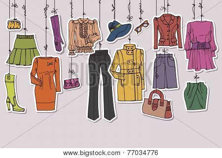 Womans clothing and accessories hanging on ropes
