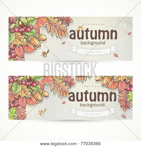 Set of two horizontal banners with the image of autumn leaves, chestnuts, acorns and berries