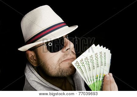 Poker Player Or A Villain Holding A Lot Of Euro Banknotes