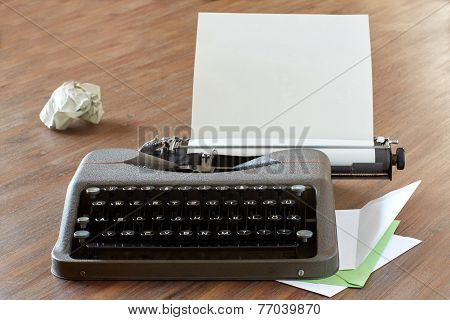 Typewriter On A Table With Letterhead Paper