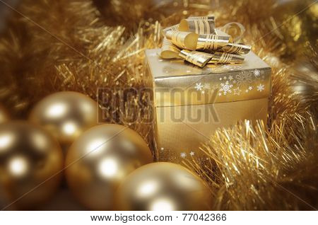 Golden Christmas Gift And Baubles