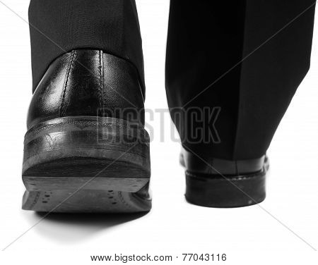 Male Suit Walking Away In Black Worn Shoes