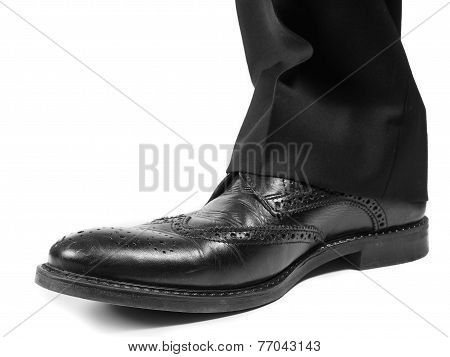 Male Suit In Black Worn Shoes