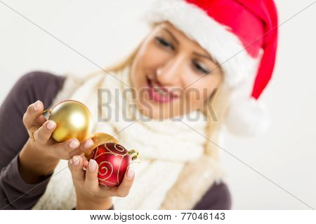 Christmas Decorations In The Hands Of The Santa Helper
