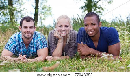 Three young people spending time outside