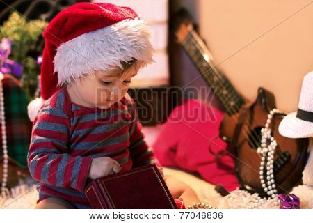Baby In Santa Hat Keep A Book