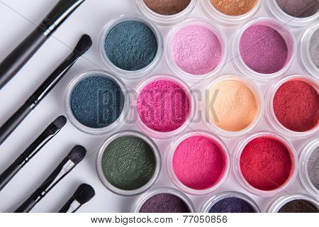 Set of bright mineral eye shadows and brushes, top view