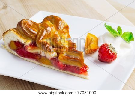 Apricot and strawberry pie on a plate