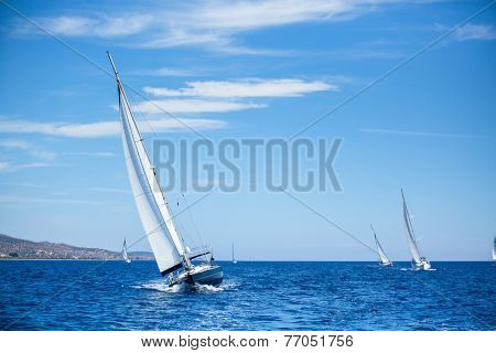 Sailing boats during a sea race. Yacht. Sailing. Yachting. Luxury Yachts.