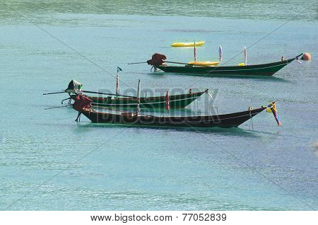 Three Longtail Boats On The Water - Traditional Thaialand