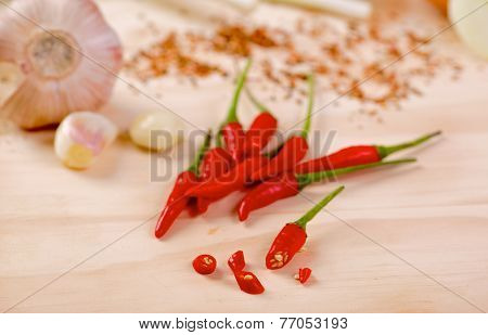 Red hot chilli peppers on a board
