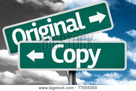 Original x Copy creative sign with clouds as the background