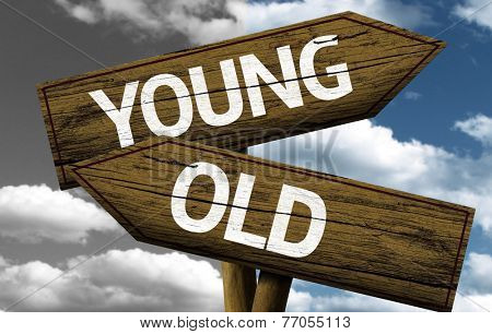 Young x Old creative sign with clouds as the background
