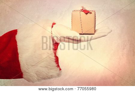 Santa Claus Giving A Small Christmas Present Box