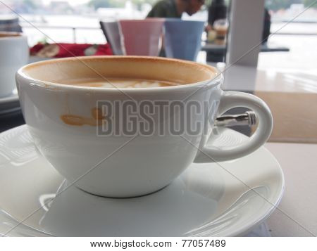 Cup of coffee with a stain