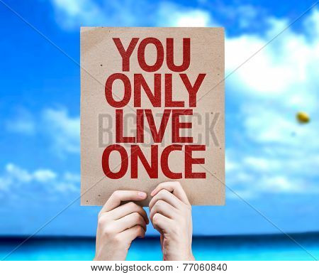 You Only Live Once card with a beach on background
