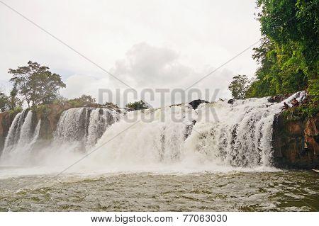 Fishermen In Waterfall