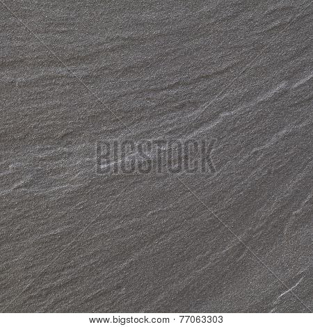 Black warm limestone rock texture and background