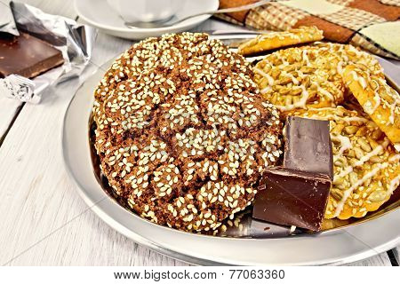 Cookies chocolate and shortbread with sesame on metal tray