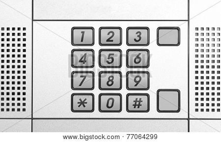 Security intercom number keypad at apartment door