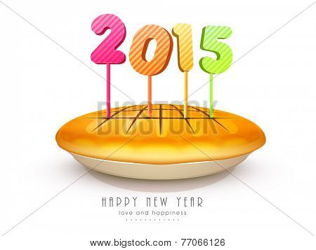 Happy New Year party celebration with colorful 2015 candles on delicious cake.