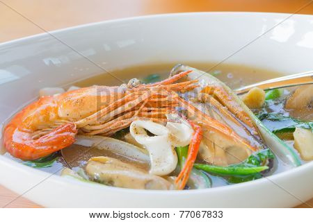Wide Rice Noodles In Gravy With Seafood