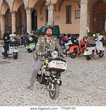 Biker Riding A Vintage Italian Scooter Vespa