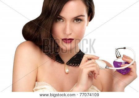 Beautiful Woman Apllying Perfume Looking In The Camera
