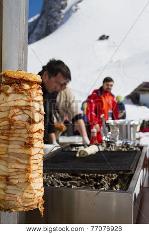 SOCHI, RUSSIA - MARCH 22, 2014: Chefs make Shawarma at the mountain ski resort