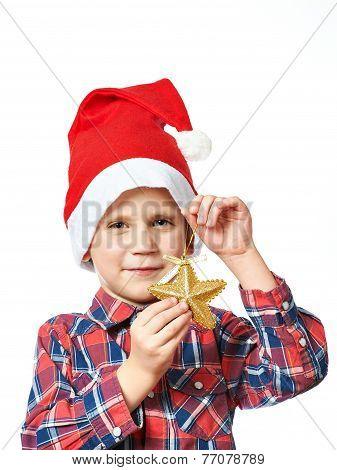 Little Boy In Red Santa Hat With Golden Star