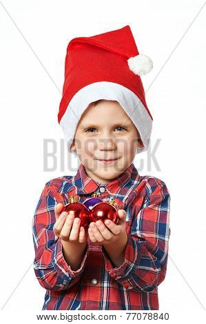 Little Boy In Red Santa Hat With Shiny Christmas Balls