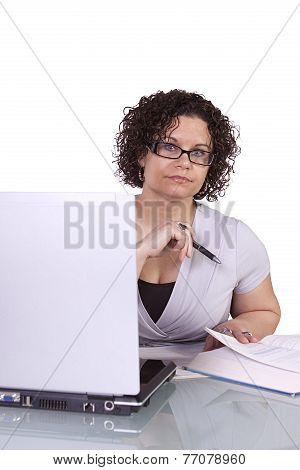 Hispanic Businesswoman At Her Desk Working