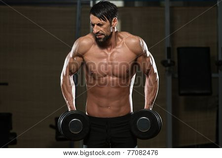 Fit Athlete Doing Exercise For Trapezius