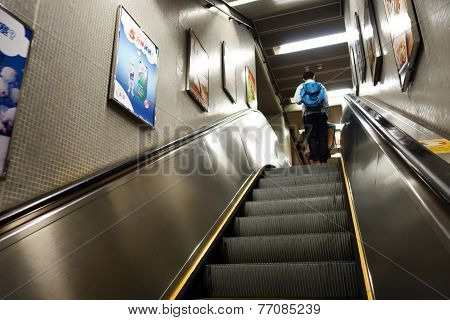 Passenger Takes Escalator To Move To Upstair In Mtr Station