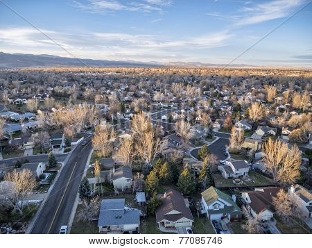 sunset over Colorado Front Range town - aerial view of Fort Collins on a typical snowless  fall or winter day from a low flying drone