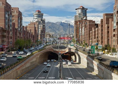 Cars Passing Through Navvab Tunnel Of Tehran With Milad Tower In The Background