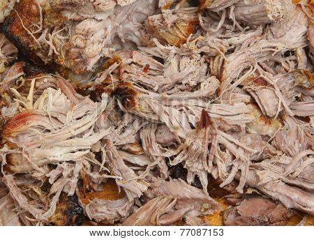 Pulled pork meat freshly shredded with forks.