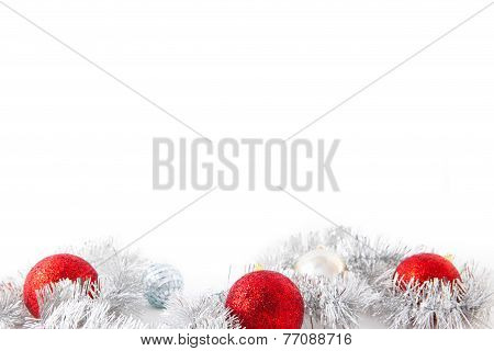 Three red new year balls and silver decoration
