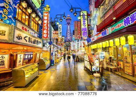 OSAKA, JAPAN - NOVEMBER 17, 2012: Crowds pass through Shinsekai district of Osaka. The area is a famed nightlife area.