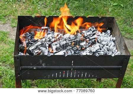 Fire In A Container For Cooking Meat