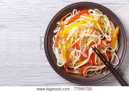 Rice Noodles With Vegetables And Chopsticks. Top View