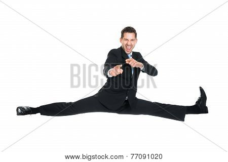 Businessman Doing Splits While Gesturing Over White Background